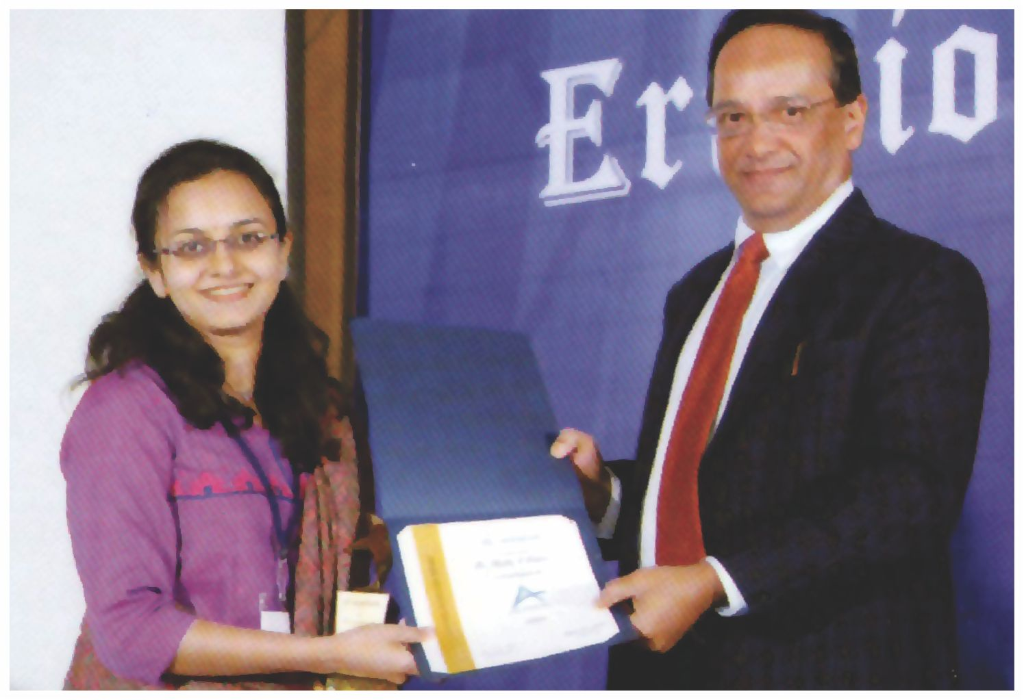 Dr.Shrutika receiving award